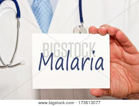 Malaria - Doctor holding sign with text in his hand