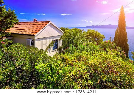 The Sunset On Adriatic Sea scenic view. Dubrovnik town Villa on coast and blue sky. Croatia.