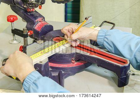 Man using circular saw to cut wood