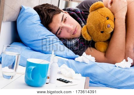 Sick ill man in the bed taking medicines and drugs
