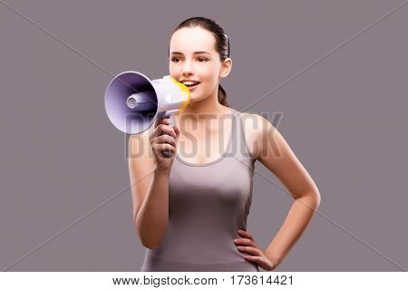 Woman in sports concept with loudspeaker