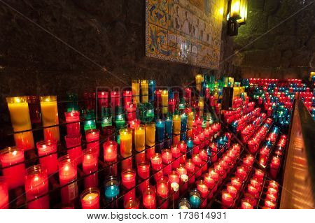 Blurred abstract background with candle lights bokeh in a Montserrat monastery, Catalonia, Spain