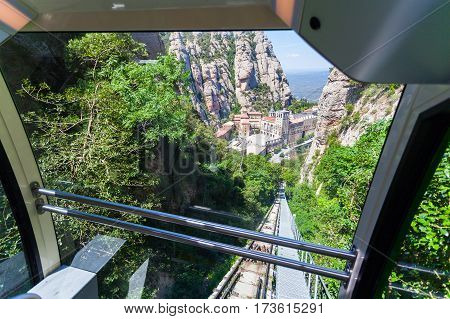 View of the Monastery of Montserrat in Catalonia from the cable car cabin, near Barcelona.