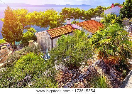 The Sunset on Adriatic Sea. Dubrovnik town, Villa on coast and blue sky. Croatia