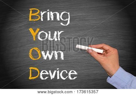 Bring Your Own Device - female hand writing text