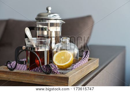 Cups Of Tea  With French Press And Lemon