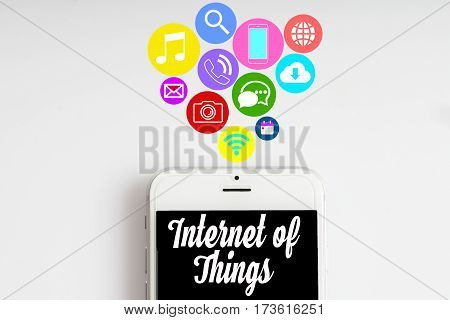 """Internet of things"" words on smartphone with social media icon with white background - business finance and copy space concept"