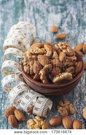 The Concept Of A Healthy Lifestyle, Nuts  And Measuring Meter
