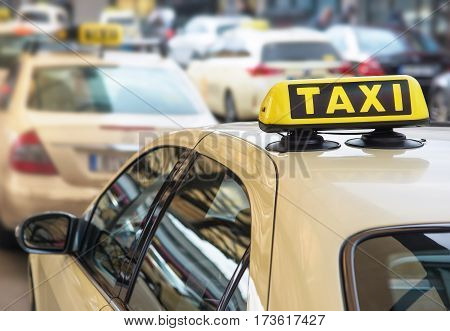 taxi sign on top of a taxi car