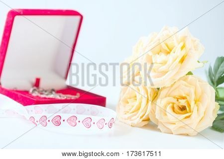 Yellow Roses And Box Packaging For Jewelry.