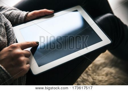 Women's hands holding the tablet. Beautiful manicure. Modern technology entertainment recreation education