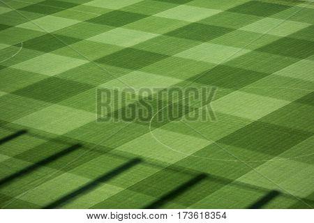Beautiful pattern of fresh green grass for football sport, football field, soccer field, team sport texture.