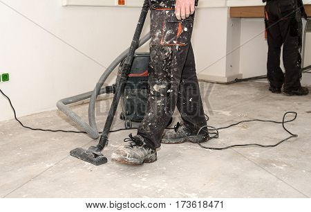 Worker Use Vacuum Cleaner In Construction