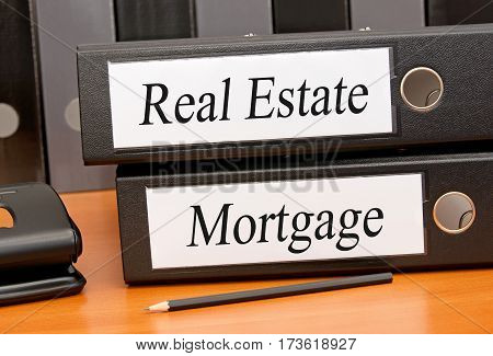 Real Estate and Mortgage - two binders on desk in the office