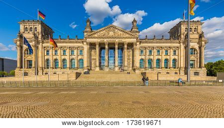 Panoramic view of famous Reichstag building seat of the German Parliament (Deutscher Bundestag) in beautiful golden evening light at sunset Berlin Germany
