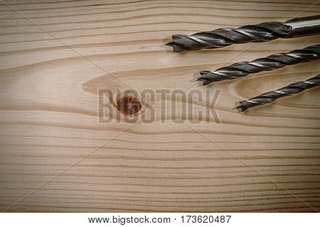 Set Of Different Drill Bits On Wooden Background
