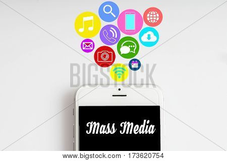 """""""Mass Media"""" words on smartphone with social media icon with white background - business finance and copy space concept"""