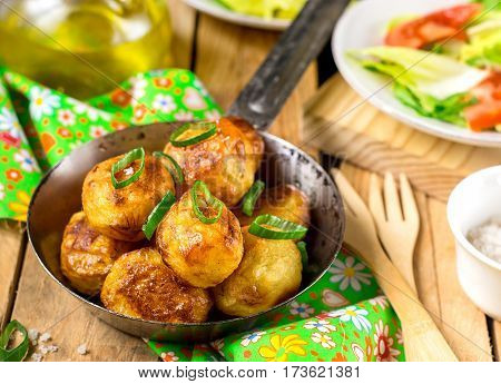 Roasted brown baby potatoes with butter salt and chives