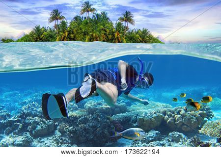 Man at snorkeling in the tropical water