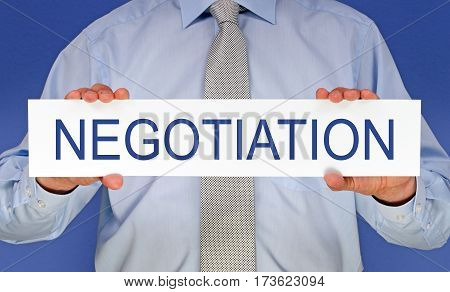 Negotiation - Manager holding sign with text