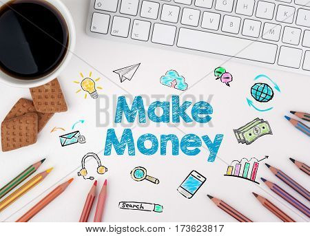 Make Money, Business concept. Computer keyboard and a coffee mug on a white table
