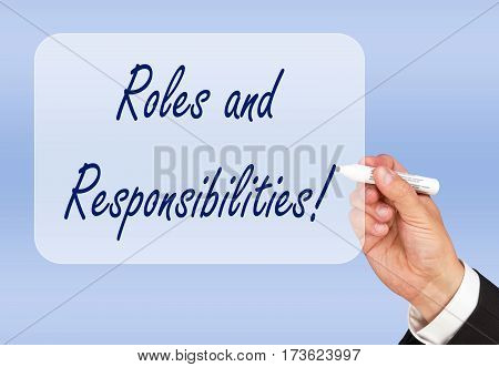Roles and Responsibilities - hand writing text on blue background