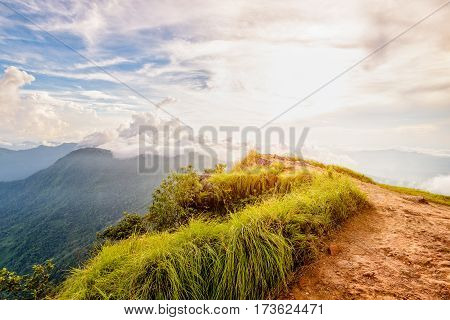 Beautiful landscape nature of high mountain colourful sunlight cloud and sky on Phi Pan Nam Range during sunset in winter from viewpoint Phu Chi Fa Forest Park at Chiang Rai Province Thailand