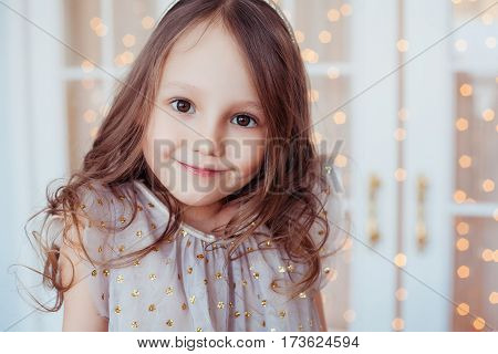 Portrait of smiling cute little girl. Fashion photo. Natural beauty.