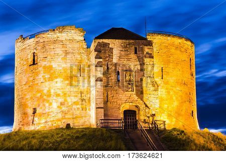 York Castle, England, is a fortified complex comprising of castles, prisons, law courts .The now-ruinous keep of the medieval Norman castle is commonly referred to as Clifford's Tower