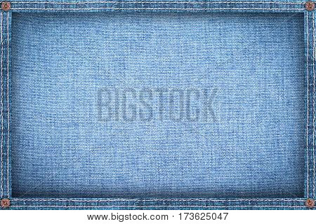 Frame made from denim blue jeans background