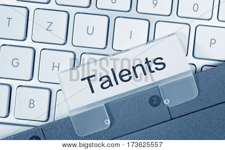 Talents - folder with text on computer keyboard