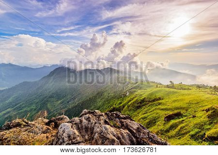 Beautiful landscape nature of high mountain cloud fog and sky on Phi Pan Nam Range during sunset in winter from viewpoint Phu Chi Fa Forest Park at Chiang Rai Province Thailand