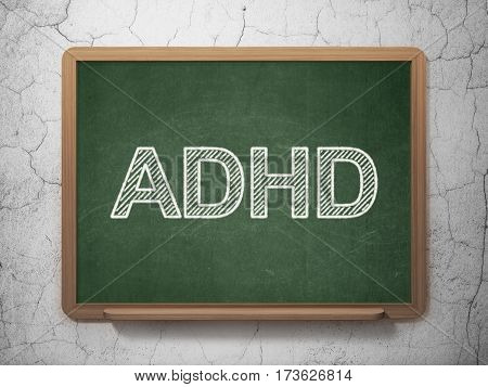 Health concept: text ADHD on Green chalkboard on grunge wall background, 3D rendering