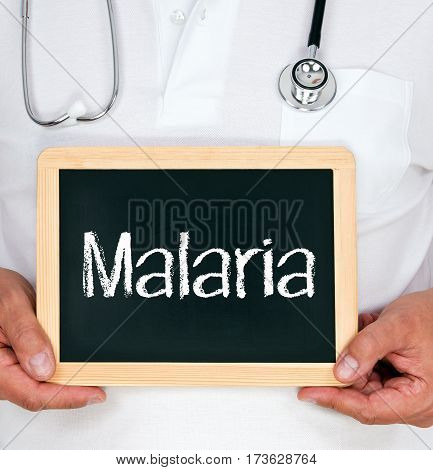 Malaria - Physician holding chalkboard with text