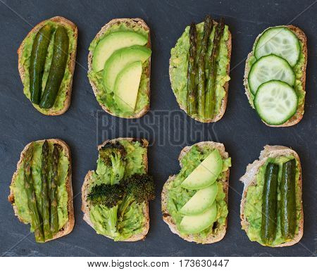 Green vegetarian sandwiches selection made with avocado courgette asparagus broccoli