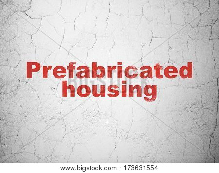 Building construction concept: Red Prefabricated Housing on textured concrete wall background