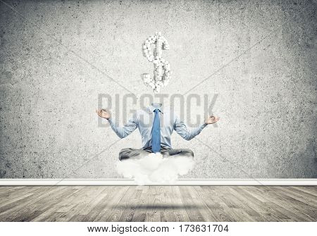 Meditating businessman with dollar sign instead of his head