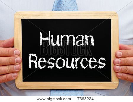 Human Resources - Businessman holding chalkboard with text
