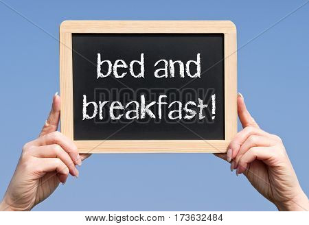 bed and breakfast - female hands holding chalkboard with text
