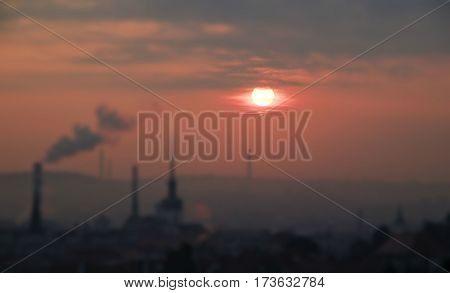 Red dawn at city of Brno during smog situation tilt shift photo
