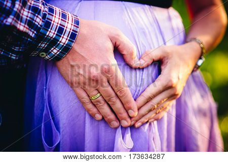 the palm of the handicap of the heart her hand his arm hands parents pregnant belly big belly