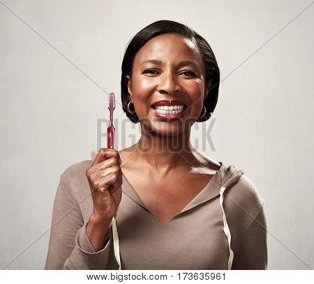 Black woman with toothbrush