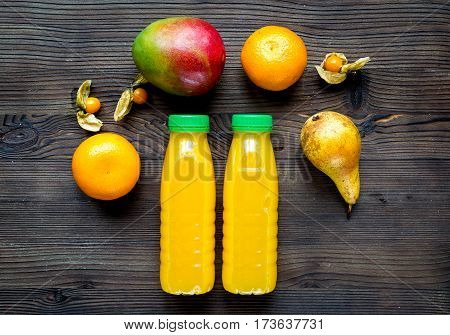 colorful plastic bottles with fruit fresh drinks on wooden table background top view mockup