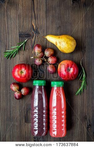 fresh multifruit drink in plastic bottle on wooden table background top view mock up