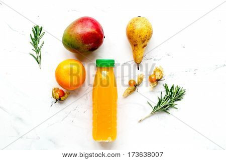 fitness fresh drink in plastic bottle on white table background top view mockup