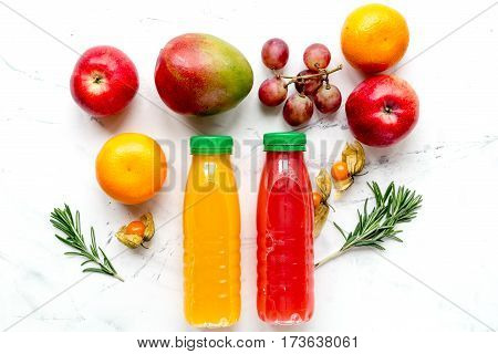 fresh multifruit juice in plastic bottle on white table background top view