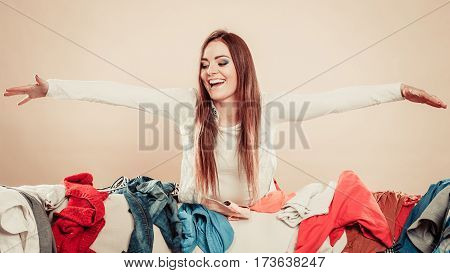 Woman Behind Messy Sofa With Outstretched Arm.