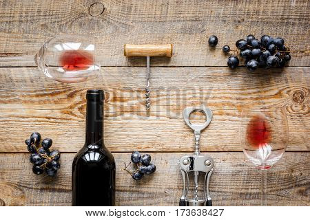 Wine set with glass, bottle and fresh grape on wooden desk top view