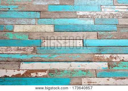 old wood texture background. Vintage wood background with blue green color peeling paint.