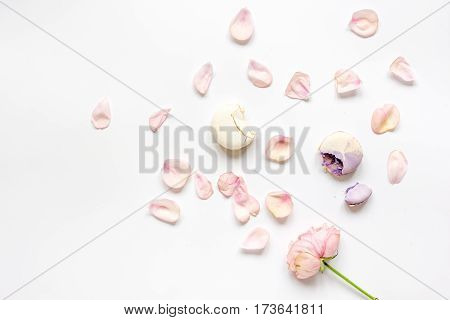 woman breakfast with rose petals and macaroons in soft light on white table background top view mockup
